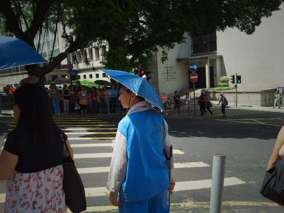 street cleaner in Hon Kong wearing an interesting hat